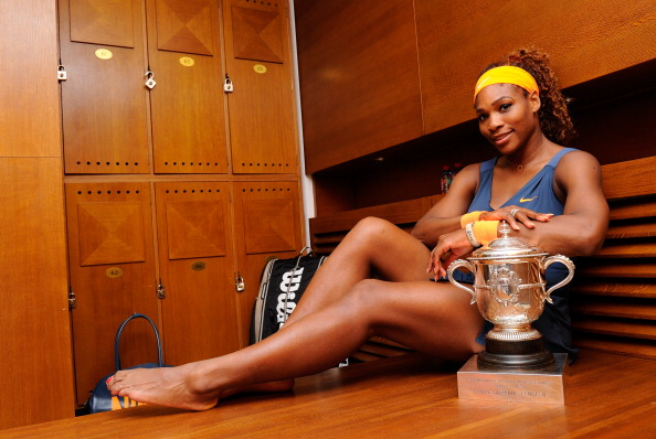 PARIS, FRANCE - JUNE 08:  Serena Williams of United States of America poses with the Coupe Suzanne Lenglen in her changing room after her women's singles final match against Maria Sharapova of Russia during day fourteen of French Open at Roland Garros on June 8, 2013 in Paris, France.  (Photo by Corinne Dubreuil/FFT/Pool/Getty Images)